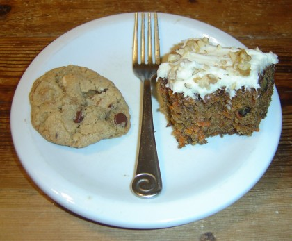 a cookie and a slice of carrot cake