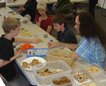 an AFE Games Group picture including lots of cookies and a plate of baby carrots