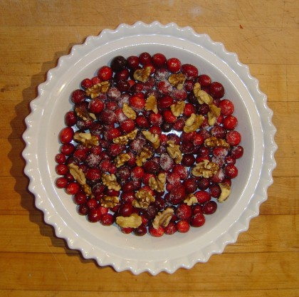 Cranberries sprinkled with sugar and walnuts, waiting for the batter to be spooned on top for Nantucket Cranberry Pie
