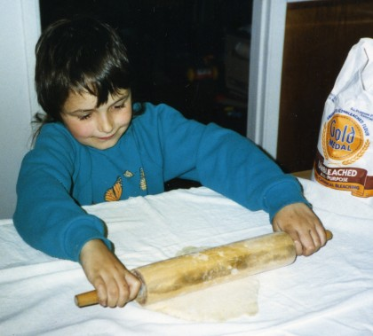 six-year-old Sam rolls out a pie crust