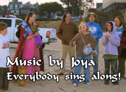 another screen from the 'Meg's Beach Party' music video, crediting Joya for the music and encouraging the audience to sing along