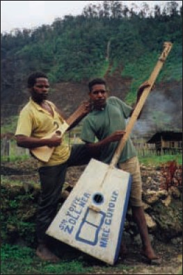 a picture of a Martin Backpacker guitar jam session with the world's last stone-age tribe on Irian Java, New Guinea in East Indonesia