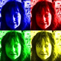 an author picture of Tané Tachyon in blue, red, yellow, and green