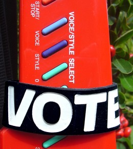 an 'I Voted' wristband from Rock the Vote being modeled by a Yamaha keytar