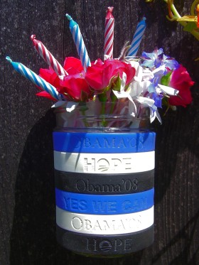 My Obama 2008 campaign 'Yes We Can' and 'Hope' wristbands with flowers and candles for President Obama's 50th birthday